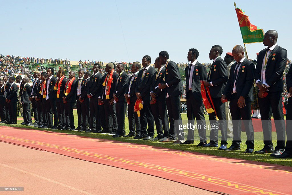 Burkina Faso's national football team players pose on February 12, 2013 at the Stade du 4-août in Ouagadougou, two days after losing the final football match of the 2013 Africa Cup of Nations against Nigeria. AFP PHOTO / AHMED OUOBA