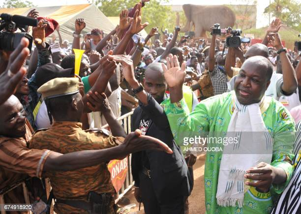 Burkina Faso's opposition leader Zephyrin Diabre is greeted by supporters as he arrives at the Maison du Peuple for a meeting in Ouagadougou on April...