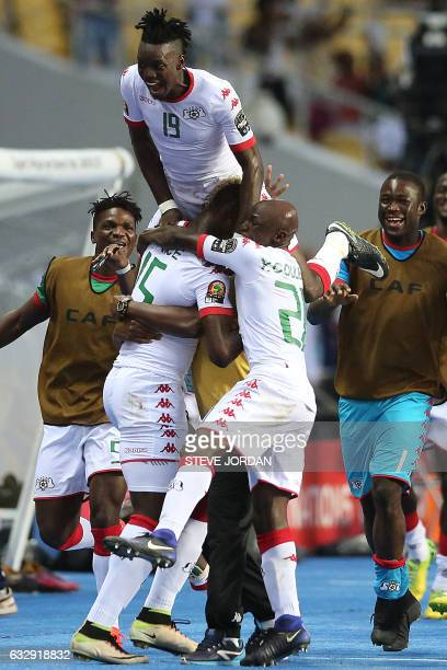 Burkina Faso's players celebrate after scoring a goal during the 2017 Africa Cup of Nations quarterfinal football match between Burkina Faso and...