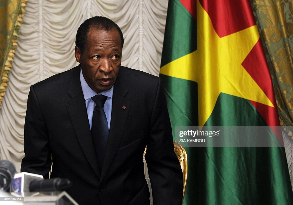 Burkina Faso's President Blaise Compaore looks on as he meets with relatives and acquaintances of the victims of the Air Algerie crash at the Presidential Palace in Ouagadougou on July 26, 2014. The second black box from the Air Algerie plane disaster was recovered on July 26 at the remote crash site in northern Mali as investigators headed to the scene to determine the cause of the tragedy. Compaore met on July 26 with relatives of some crash victims in Ouagadougou and announced that Burkina Faso has opened an official inquiry into the cause of the disaster. AFP PHOTO/ SIA KAMBOU