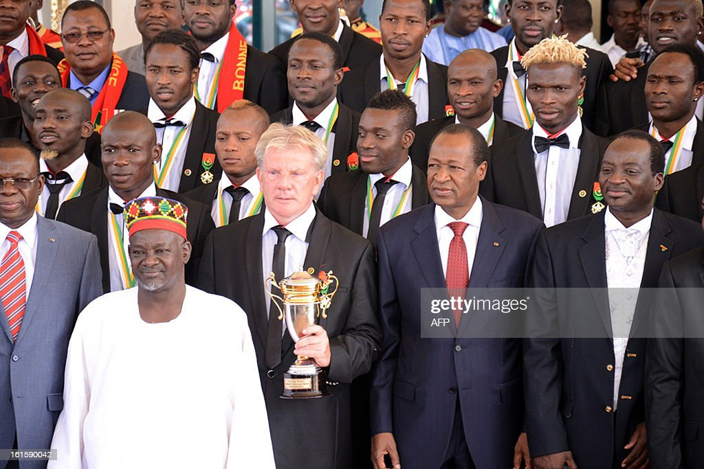 Burkina Faso's president Blaise Compaore (front row, 2nd R) poses with Burkina's national football team players, Belgian coach Paul Put and the Mogho Naba, title of the kings of the Mossi kingdom (front row 2nd L), on February 12, 2013 in Ouagadougou, two days after they lost the 2013 Africa Cup of nations final football match against Nigeria.