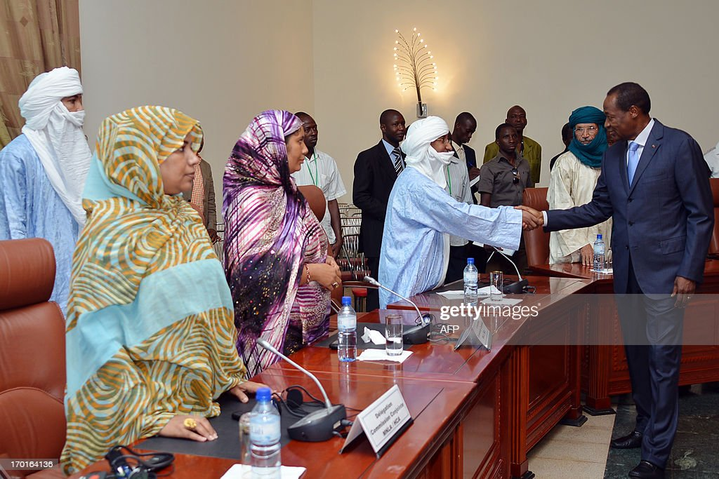 Burkina Faso's President Blaise Compaore (R) shakes hands on June 8, 2013 a member of a Tuareg delegation before the start of a meeting on the Malian crisis in Ouagadougou, Burkina Faso. Talks between Malian authorities and armed ethnic Tuareg groups, who hold the northeastern town of Kidal, got underway on June 8 after a day's delay.