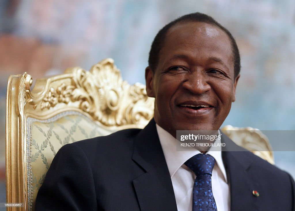 Burkina Faso's President Blaise Compaore smiles on January 23, 2013 during a meeting with France's Junior Minister for Foreign Countries and Development at the Presidential Palace in Ouagadougou. The conflict in Mali has caused nearly 150,000 people to flee the country, while about another 230,000 are internally displaced, the UN humanitarian agency said on January 15, 2013. According to OCHA, the UN High Commissioner for Refugees has registered 144,500 refugees in neighbouring countries - 54,100 in Mauritania, 50,000 in Niger, 38,800 in Burkina Faso and 1,500 in Algeria -. AFP PHOTO KENZO TRIBOUILLARD