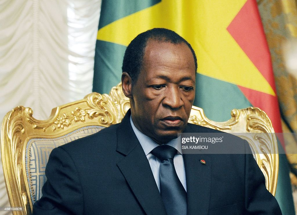 Burkina Faso's President Blaise Compaore waits prior to meeting relatives and acquaintances of the victims of the Air Algerie crash at the Presidential Palace in Ouagadougou on July 26, 2014. The second black box from the Air Algerie plane disaster was recovered on July 26 at the remote crash site in northern Mali as investigators headed to the scene to determine the cause of the tragedy. Compaore met on July 26 with relatives of some crash victims in Ouagadougou and announced that Burkina Faso has opened an official inquiry into the cause of the disaster. AFP PHOTO/ SIA KAMBOU