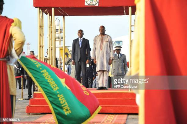 Burkina Faso's President Roch Marc Christian Kabore and Benin's President Patrice Talon stand during a welcoming ceremony for Talon at Ouagadougou...