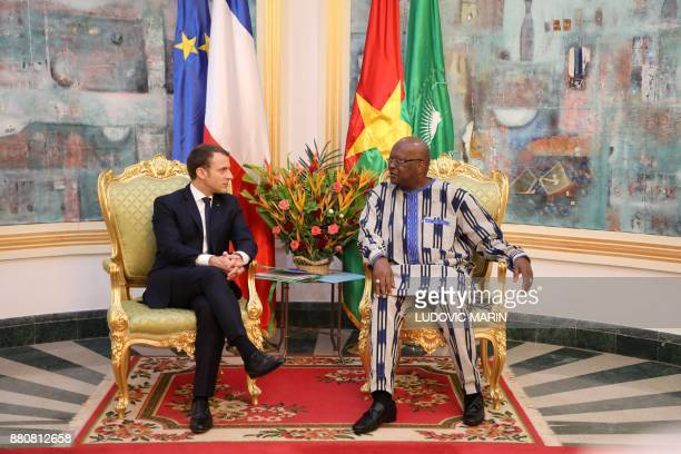 Burkina Faso's President Roch Marc Christian Kabore meets with France's President Emmanuel Macron at the Presidential Palace in Burkina Faso on...