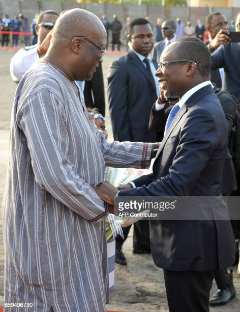 Burkina Faso's President Roch Marc Christian Kabore shakes hands with Benin's President Patrice Talon during a welcoming ceremony for Talon at...