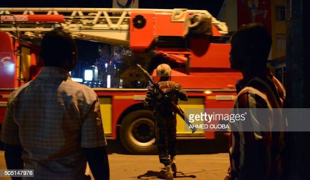 Burkina Faso's soldier stands near Hotel Splendid where the attackers remain with sporadic gunfire continuing in Burkina Faso's capital Ouagadougou...