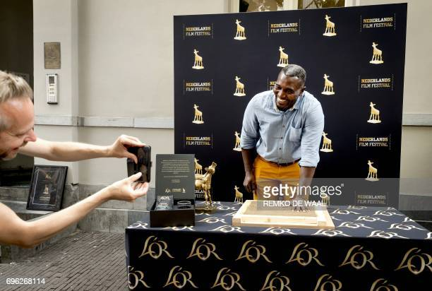 Burkinabe actor Issaka Sawadogo gives his handprint for the Golden Tile in Utrecht on June 15 2017 Sawadogo is honoured in the streets of Utrecht...