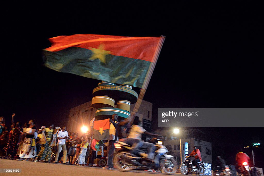 Burkinabe celebrate on February 6, 2013 on the 'Monument des Cineastes' in Ouagadougou after their national football team won the Africa Cup of Nations semi-final match over Ghana. Burkina Faso defeated Ghana 3-2 on penalties Wednesday after their Africa Cup of Nations semi-final ended 1-1 after extra time at Mbombela Stadium.