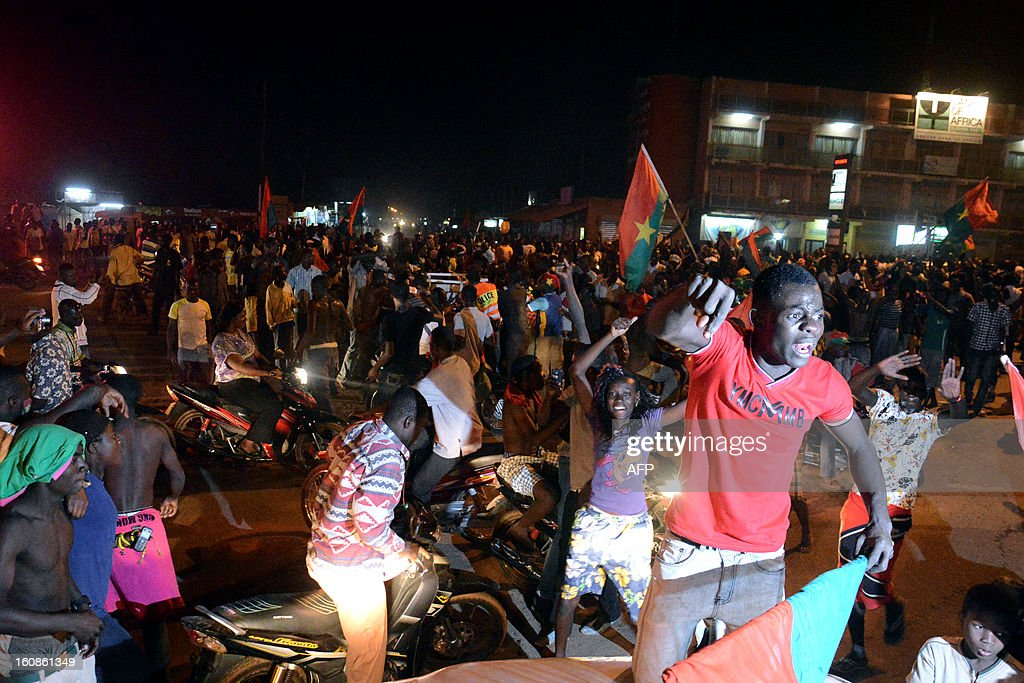 Burkinabe celebrate on February 6, 2013 on the streets of Ouagadougou after their national football team won the Africa Cup of Nations semi-final match over Ghana. Burkina Faso defeated Ghana 3-2 on penalties on February 6 after their Africa Cup of Nations semi-final ended 1-1 after extra time at Mbombela Stadium.