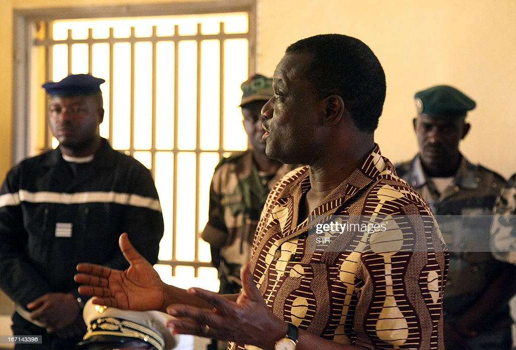 Burkinabe President of the Economic Community of West African States (ECOWAS) Commission, Kadre Desire Ouedraogo (4th R), speaks to military officers during a visit to Franco-African troops in Gao on April 21, 2013. Ouedraogo encouraged Franco-African troops in Mali to 'not release the pressure' against the Islamists armed groups.