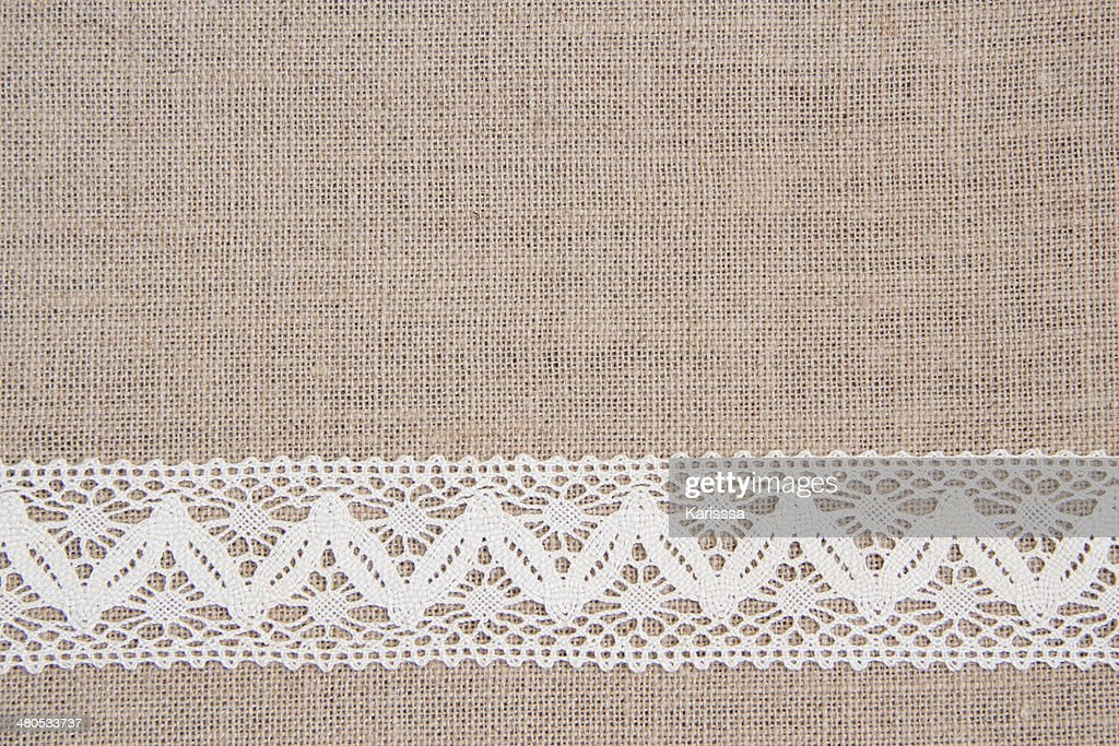 Burlap background with lace : Stock Photo