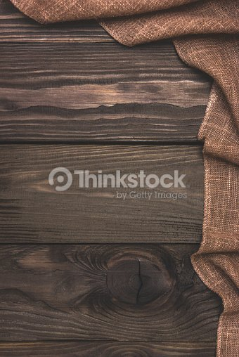 burlap cloth on an old wooden background foto de stock thinkstock