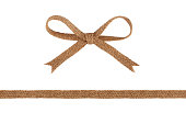 Burlap woven ribbon and bow isolated on white background.