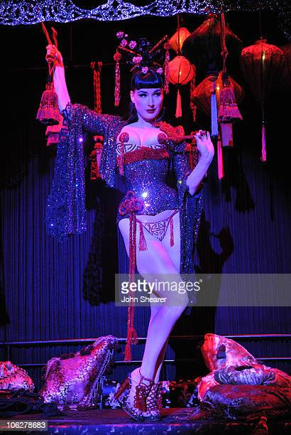 Burlesque artist Dita Von Teese performs at the amfAR Inspiration Gala celebrating men's style with Piaget and DSquared 2 at Chateau Marmont on...