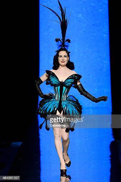 Burlesque artist Dita Von Teese walks the runway at the Jean Paul Gaultier Spring Summer 2014 fashion show during Paris Haute Couture Fashion Week on...