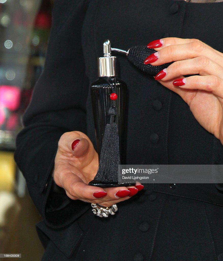 Burlesque dancer Dita Von Teese (hands, ring and fingernail detail) attends the U.S. launch of her fragrance 'Rouge' at Apothia by Ron Robinson at Fred Segal Melrose on December 15, 2012 in Los Angeles, California.