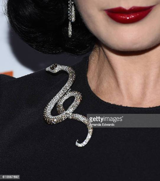 Burlesque performer Dita Von Teese broach detail attends the launch party for Cassandra Peterson's new book 'Elvira Mistress Of The Dark' at the...