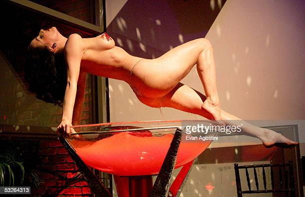 Burlesque performer Dita Von Teese performs her act at Virgin Mobile's '3 Ways To Pay As You Go' launch party at Sky Studio on July 20 2005 in New...