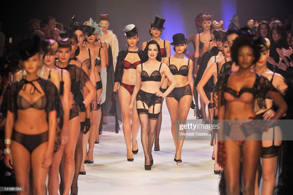 Burlesque performer Dita Von Teese showcases a design by Von Follies by Dita Von Teese during the Von Follies show on day three of the 2012 L'Oreal Melbourne Fashion Festival on March 10, 2012 in Melbourne, Australia.