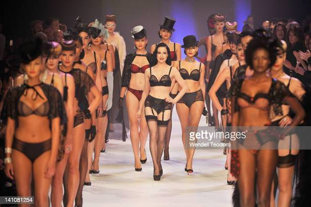 Burlesque performer Dita Von Teese showcases a design by Von Follies by Dita Von Teese during the Von Follies show on day three of the 2012 L'Oreal...