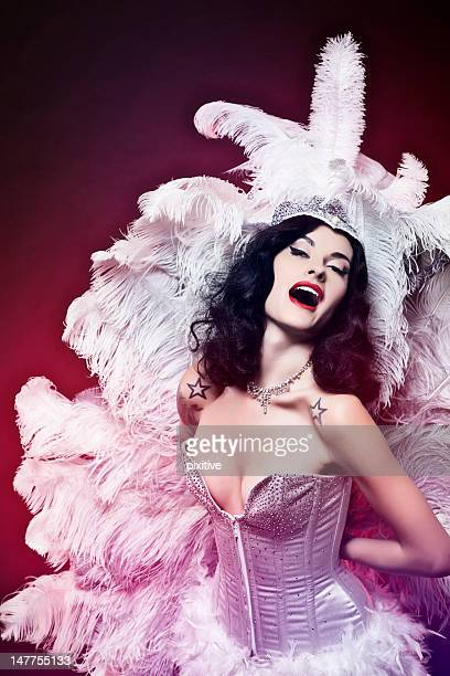 Burlesque woman in light purple on dark red background