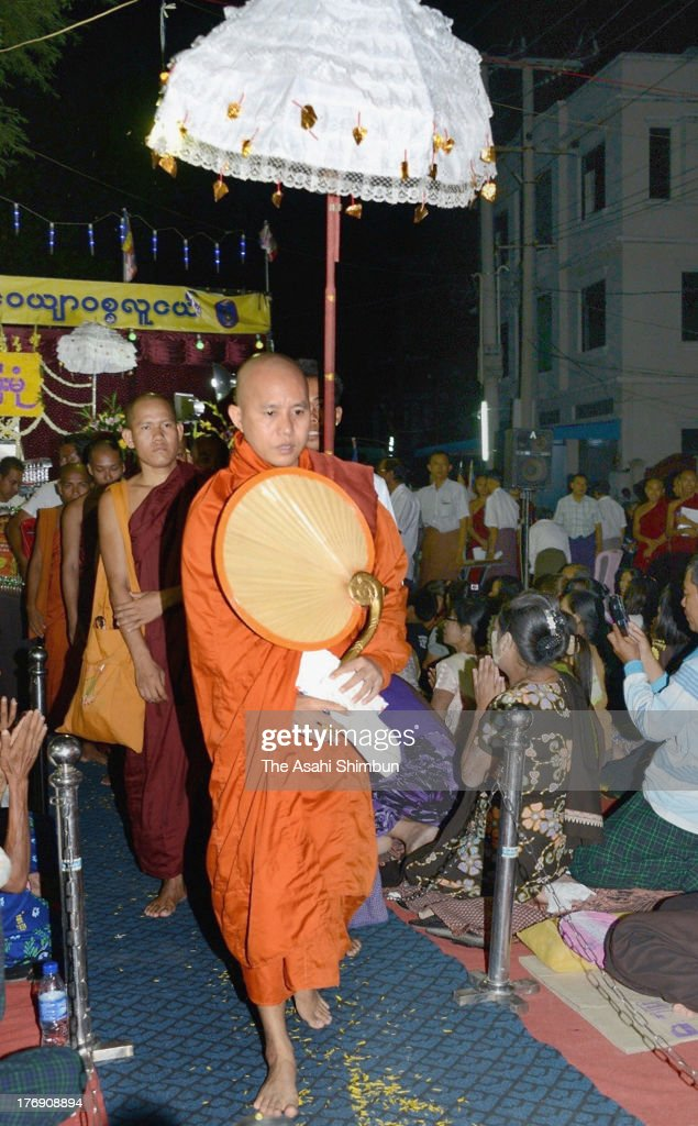 Burmese Buddhist monk Ashin Wirathu leaves the preaching ceremony as the followers saw him off on June 23, 2013 in Mandalay, Myanmar. Wirathu leads the anti-Muslim movement called '969,' and followers acknowledge the movement as the nationalist effort to protect Myanmar's majority. The July 1, 2013 issue of TIME magazine featuring Wirathu on its cover as 'The Face of Buddhist Terror' was issued a ban by the government of Myanmar.