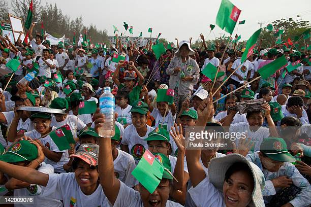Burmese cheer at a rally with the government sponsored Union Solidarity and Development Party by former military general and General Secretary U Htay...