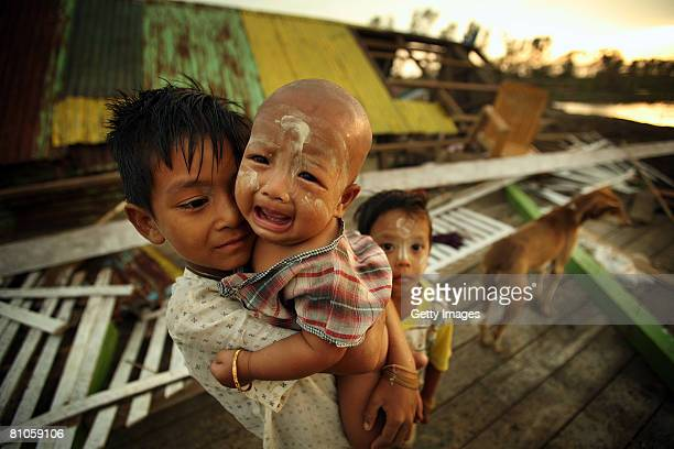 Burmese child holds a crying infant on May 12 in Maubin Myanmar It has been estimated that more than 100000 people were killed by Cyclone Nargis...