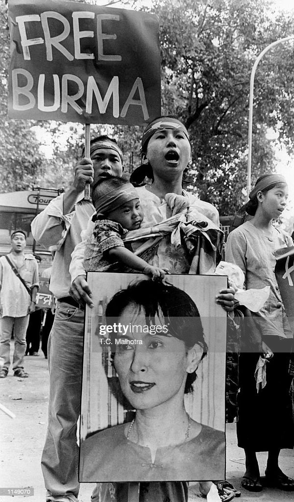 Burmese democratic activists shout slogans against the military junta during a rally to mark the 10th aniversary of anti-government uprising in New Delhi August 08,1998. The demonstrators hold posters of Aung Sang Suu Kyi, the leader of the democratic forces in Burma.