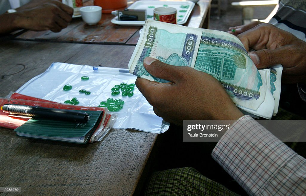 Burmese gem dealer counts Burmese Chat at a Jade market June 152003 after making a sale in Mandalay Myanmar The country generates a considerable...