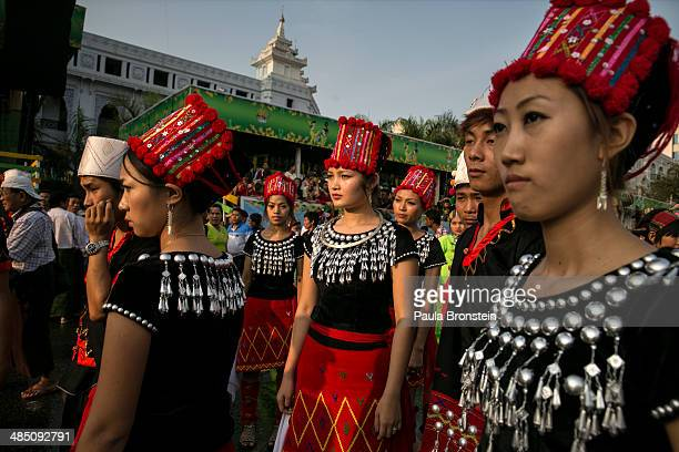 Burmese Kachin women wearing their traditional clothing wait to take part in the closing ceremony on the fourth day of the Burmese new year water...