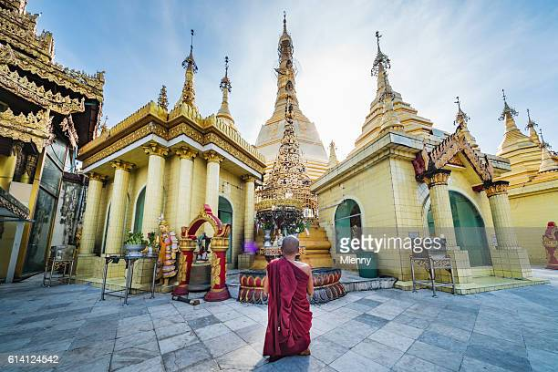 Burmese Monk Praying at Sule Pagoda Myanmar
