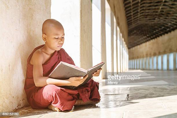 Burmese Monk Reading Buddhist Book Monastery Archway Bagan Myanmar
