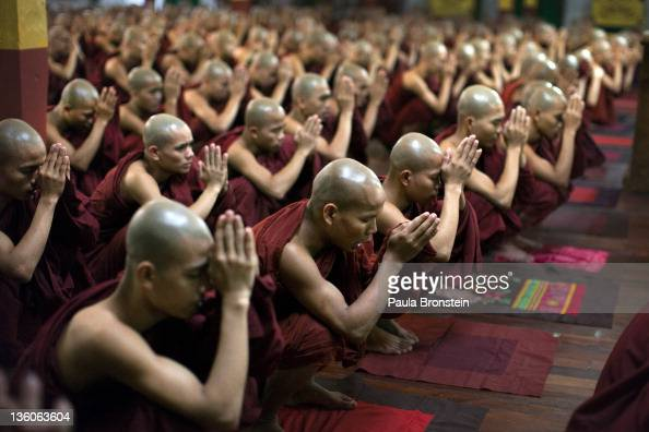 Burmese monks pray together Kha Khat Wain Kyaung monastery which is one of the three largest in the country December 13 2011 in Bago Myanmar...