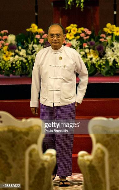 Burmese President U Thein Sein walks back to his seat after a speech at the opening ceremony of the ASEAN summit on November 12 2014 in Naypyidaw...