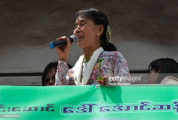 Burmese prodemocracy leader Aung San Suu Kyi speaks to Burmese migrant workers on a trip to a Burmese migrant community outside of Bangkok May 30...