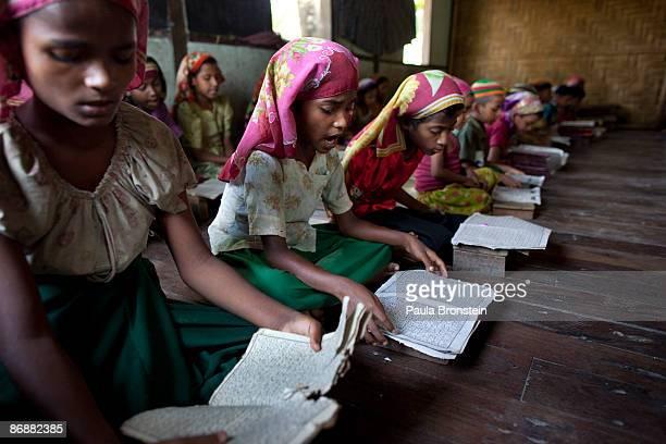 Burmese Rohingya madrassa students read the Koran during religious class on May 4 2009 in Sittwe Arakan state Myanmar The Rohingya Muslim minority...