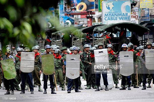 Burmese security forces block the access to a downtown street