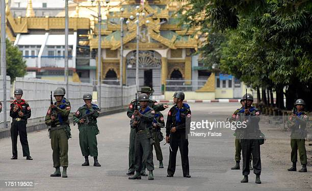 Burmese soldiers guard an access street to the Sule pagoda one of the most respected Buddhist shrines in Burma and a rallying point for antijunta...
