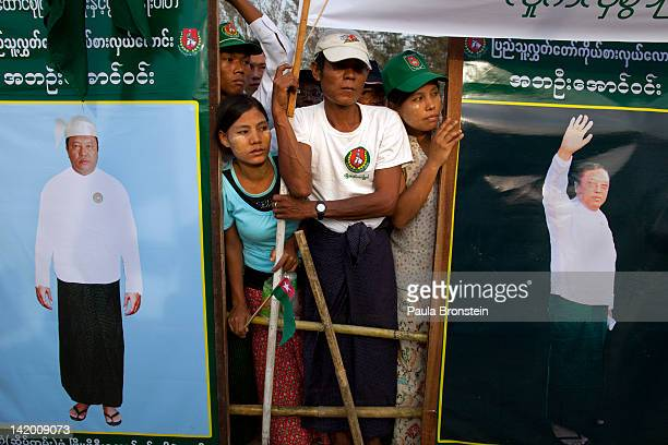 Burmese wait at a rally with the government sponsored Union Solidarity and Development Party for the arrival of former military general and General...