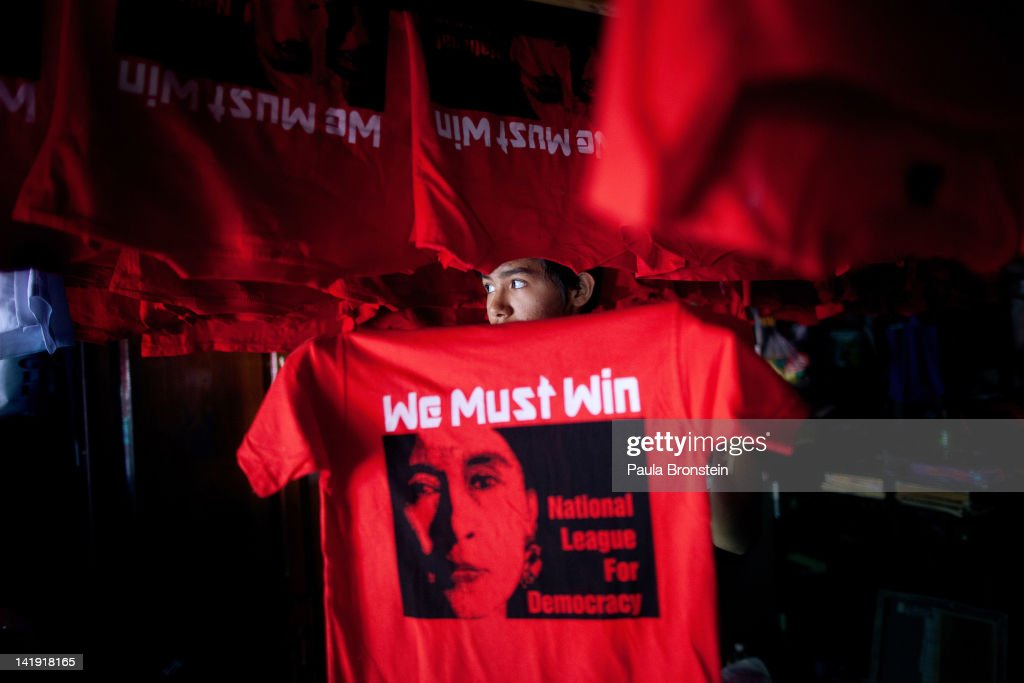 Burmese worker hangs up freshly silkscreened National League for Democracy party tshirt ahead of the parliamentary elections March 26 2012 in Yangon...