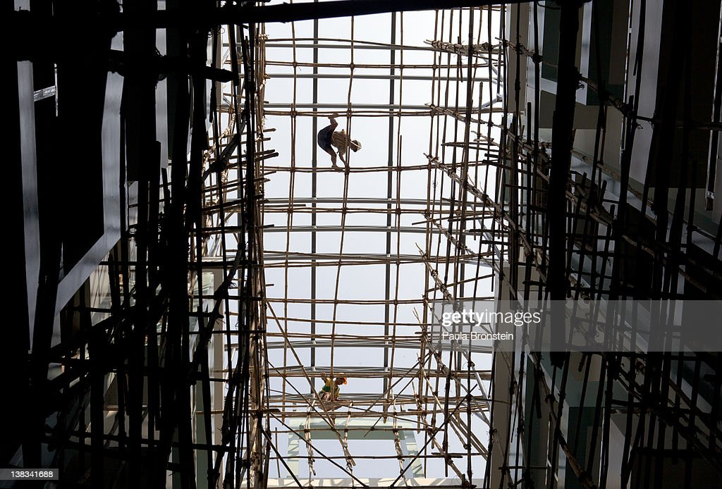 Burmese workers climb on the scaffolding at a condominium complex under construction February 6, 2012 in Yangon, Myanmar. In the unreliable and volatile market of Burma many big investors have put all of their money in the real estate market as a building boom continues in Yangon. As the country opens up to the outside world and Suu Kyi begins her campaign ahead of April 1 by-elections, her decision to stand for a seat in parliament is the latest sign of dramatic political changes taking place in the country.