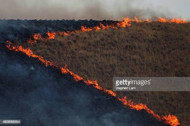 A burn operation is seen along Morgan Valley Road during the Jerusalem Fire on August 11 2015 near Lower Lake California The fire has consumed 16000...