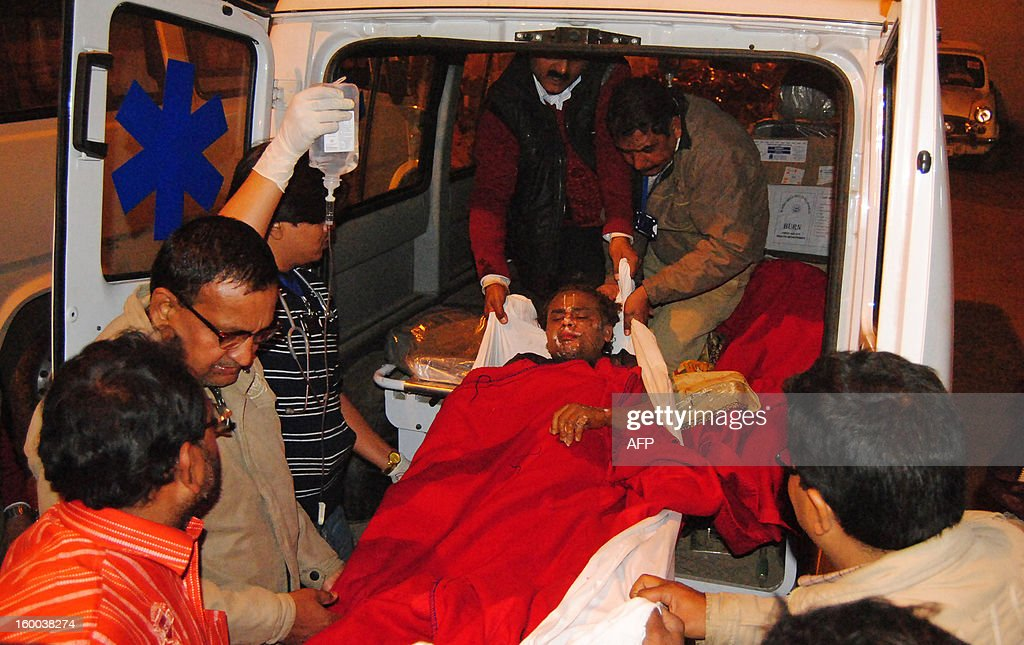 A burn victim receives assistance into an ambulance after a fire destroyed tents at the Kumbh Mela in Allahabad on January 25, 2013. Nineteen people were injured when a fire broke out at the Triveni area of Kumbh Mela in Allahabad district, a local report said citing officials. The Kumbh Mela in the Indian town of Allahabad will see up to 100 million worshippers gather over the next 55 days to take a ritual bath in the holy waters, believed to cleanse sins and bestow blessings