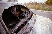 Burned car by the side of the road
