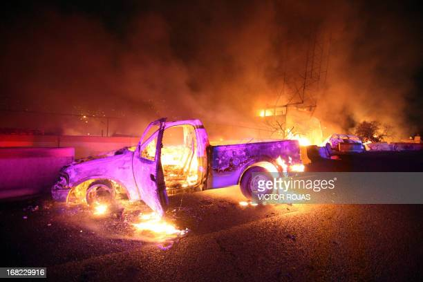 Burned cars are pictured in a highway in Ecatepec near Mexico city on May 7 2013 A gas tanker exploded in a Mexico City suburb on Tuesday killing at...