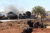 Burned cars are seen at side after the Russian airstrikes target a marketplace where fuel elements are sold in Tirmanin town of Idlib Syria on July...