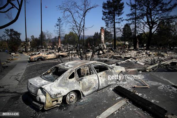 Burned cars sit in front of homes that were destroyed by the Tubbs Fire on October 12 2017 in Santa Rosa California Twenty four people have died in...